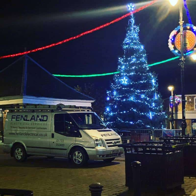 Fenland Electrical Services next to Christmas tree